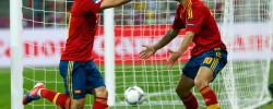 Eddie Keogh/Reuters. Spain's David Silva, left, celebrated with his teammate Cesc Fabregas after scoring the first goal against Italy.  Get European Soccer result from www.kismaayodaily.com