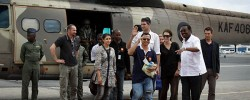 Released aid workers Qurat-Ul-Ain Sadazai, a Canadian citizen of Pakistani origin, center-left, Glenn Costes of the Philippines, center-right, Steven Dennis of Canada, above-center-right, and Astrid Sehl of Norway, 3rd-right, arrive back by Kenyan military helicopter at Wilson airport in Nairobi, Kenya, Monday, July 2. A pro-government Somali militia group said Monday that it rescued the four aid workers kidnapped by gunmen from a refugee camp in Kenya last week. Get Somali news around the world at www.kismaayodaily.com