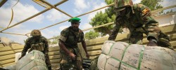 UPDF soldiers unload supplies in Somalia. Photo. UgandaObserver. www.kismaayodaily.com - your gateway of major African news around the world.
