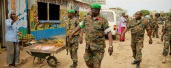African Union Mission in Somalia (AMISOM) Force Commander Lt. Gen. Andrew Gutti (centre) gestures towards a Somali man during a visit to Afgoye Town. www.kismaayodaily.com - your gateway of Somali news around the world.