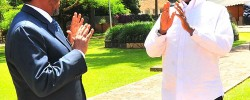 Somali president (left) gestures to President Museveni. PPU Photo newvision. www.kismaayodaily.com - your gaeway of Somali news around the world.