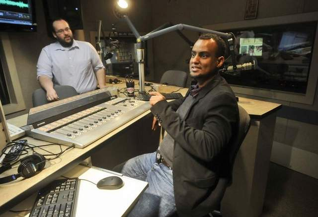Yusuf and Prchal talk Thursday, March 21 in a studio at St. Cloud State University's KVSC 88.1 FM in Stewart Hall. Yusuf is the project developer for St. Cloud Somali Radio. / Kimm Anderson. www.kismaayodaily.com - your gateway of Somali news around the world.