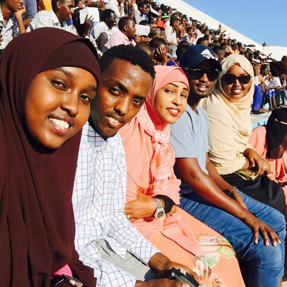 Football Fan Aisha Mohamed Mahmoud left enjoys an earlier football match at stadium Banadir PHOTO | by CECAFA Media Committee www.kismaayodaily.com - your gate way of Somali/Djibouti Sports news around the world,
